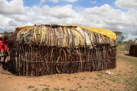 A bit of plastic sheeting enhances the roof of a traditional house
